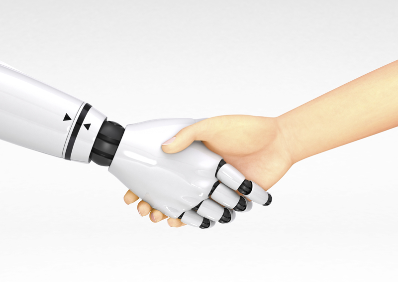Human and robot shaking hands.